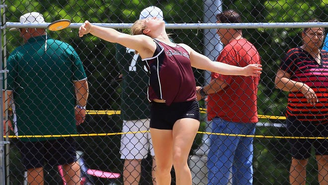 Calallen's Alexis Sacky throws the discus as she competes in the girls discus during the Region IV-5A Track and Field meet at Alamo Stadium in San Antonio.