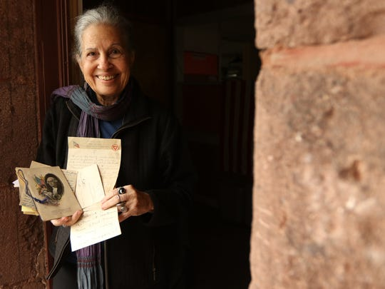 Irmari Nacht, Co-President of the Englewood Historical Society, poses with letters sent to Ethel Mahoney during WWI. Thursday, October 26, 2017