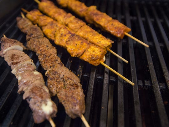 Kabobs are grilled in the kitchen at Maza Kabob, 2427