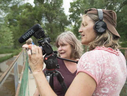 "Mona Maser and Shari Due frame a shot on the Poudre River Trail Thursday, June 23, 2016 for their upcoming film, ""Watering the West."" The duo is also behind ""Beers Bikes Bands & Broke,"" a documentary about artists and the affordable housing crisis."