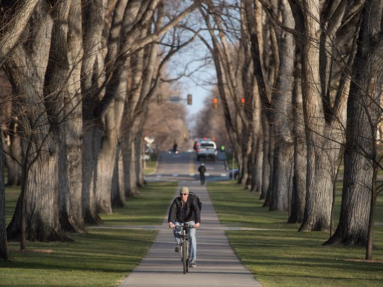 A cyclist makes his way through the Colorado State University Oval in Fort Collins during Winter Bike to Work Day in this 2017 file photo.