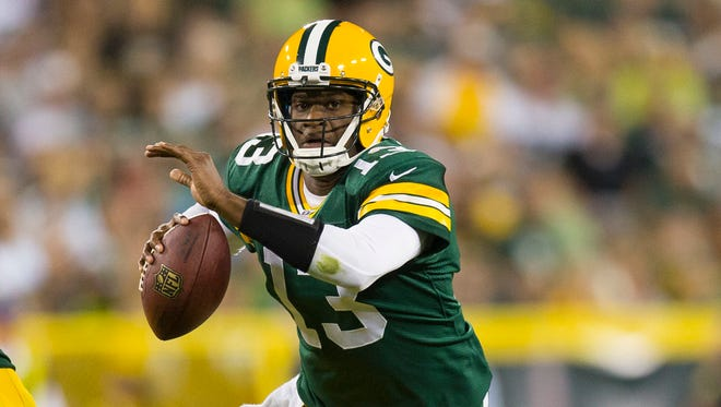 Green Bay Packers quarterback Vince Young (13) rushes with the football during the third quarter against the Seattle Seahawks at Lambeau Field.  Seattle won 17-10.