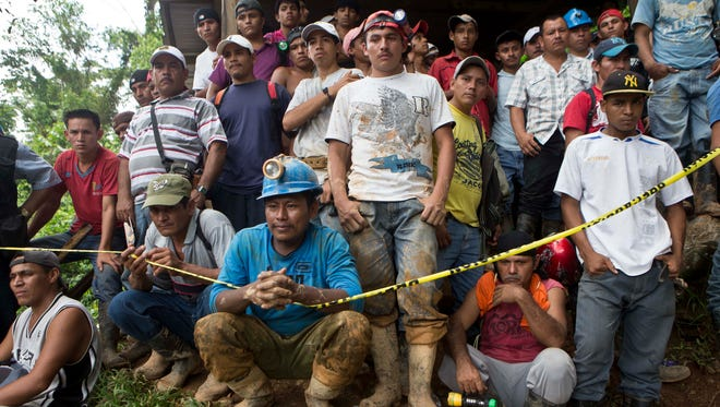 Miners wait for their turn to help in the rescue operations at El Comal gold and silver mine after a landslide trapped at least 24 miners inside, in Bonanza, Nicaragua, on Aug. 29, 2014.
