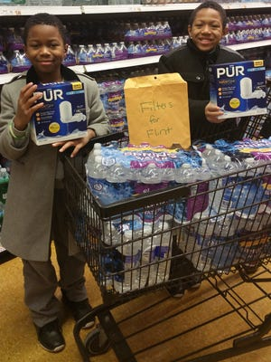 The West brothers shop for water and filters to send to Flint, Michigan.
