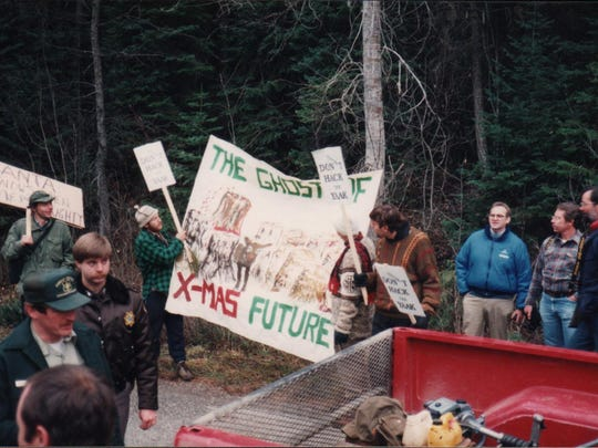 A group protests the cutting of the Capitol Christmas tree in 1989.