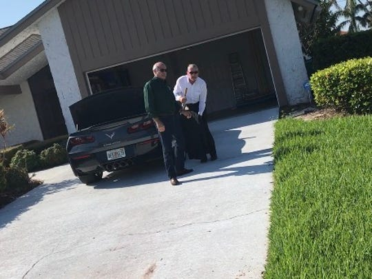 Lee County Commissioner John Manning (right) gets out