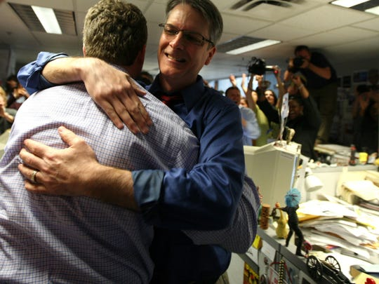 Reporters M.L. Elrick, left, and Jim Schaefer celebrate April 20, 2009, after winning the Pulitzer Prize for breaking the Kwame Kilpatrick corruption saga.