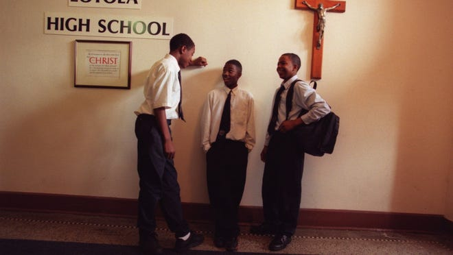 This is a 1999 photo of students at Detroit's all-boys Catholic Loyola High School. Students at the school in northwest Detroit have made a YouTube video inviting Pope Francis to visit the Motor City in 2015.