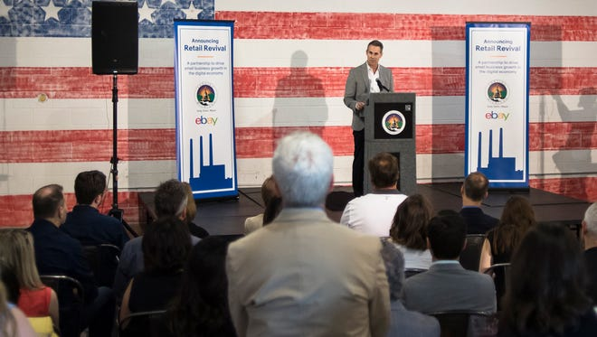 """Scott Cutler, senior vice president of eBay Americas, speaks Friday, Aug. 10, 2018, during a news conference at the Lansing Brewing Company, announcing eBay's partnership with the city of Lansing as part of eBay's """"Retail Revival"""" program."""