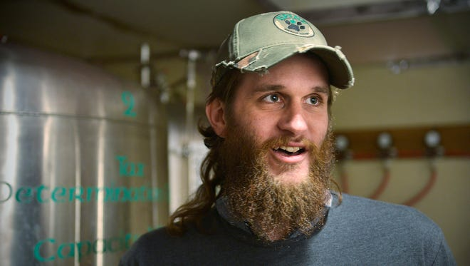 Lupine Brewing Co. Brewmaster Grant Aldrich smiles Thursday as he talks about the path he took to become brewmaster and some of the different beers he's created.