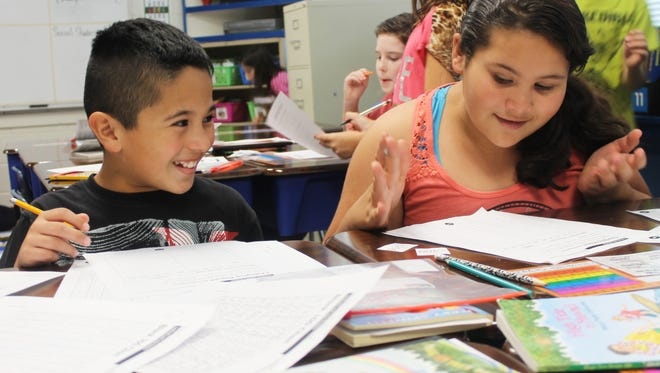 Isaiah Venegas and Liliana Miranda, fourth graders in Mrs. Evan's class, work on classwork together.