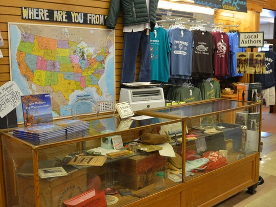 A map behind the counter at Schroeder's Department Store in Two Rivers shows how customers from around the country have dropped in.
