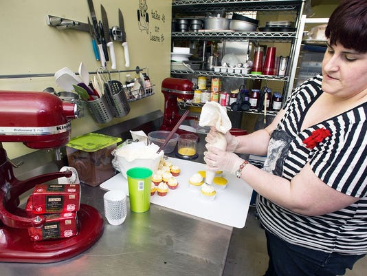 Jessica Brooks ices cupcakes at Ladybug Baking, 30 No Beaver St. York Pa Wednesday April 3, 2013.   YORK DAILY RECORD/SUNDAY NEWS - PAUL KUEHNEL