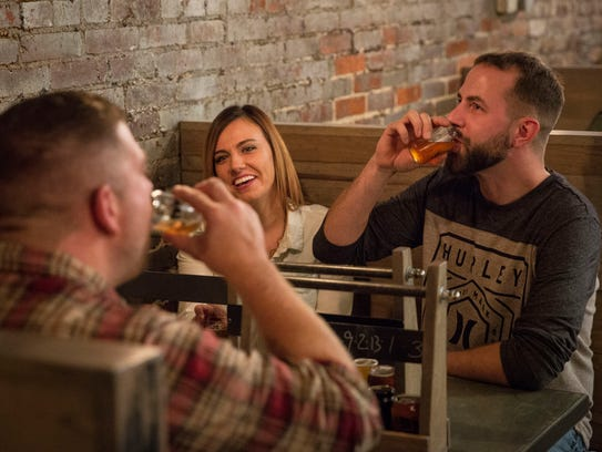 Patrons drink craft beer at Elm Street Brewing Company,