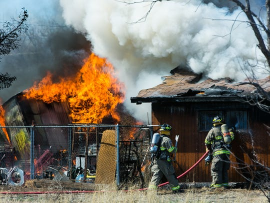Doña Ana County firefighters fight a fire on Old Picacho