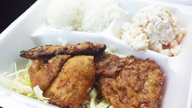 The barbecue chicken plate ($8) from Island Girl comes with marinated chicken served on a bed of cabbage with a side of macaroni salad and white rice.