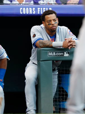 Dominic Smith, right, watch from the dugout  June 21, 2018, in Denver.