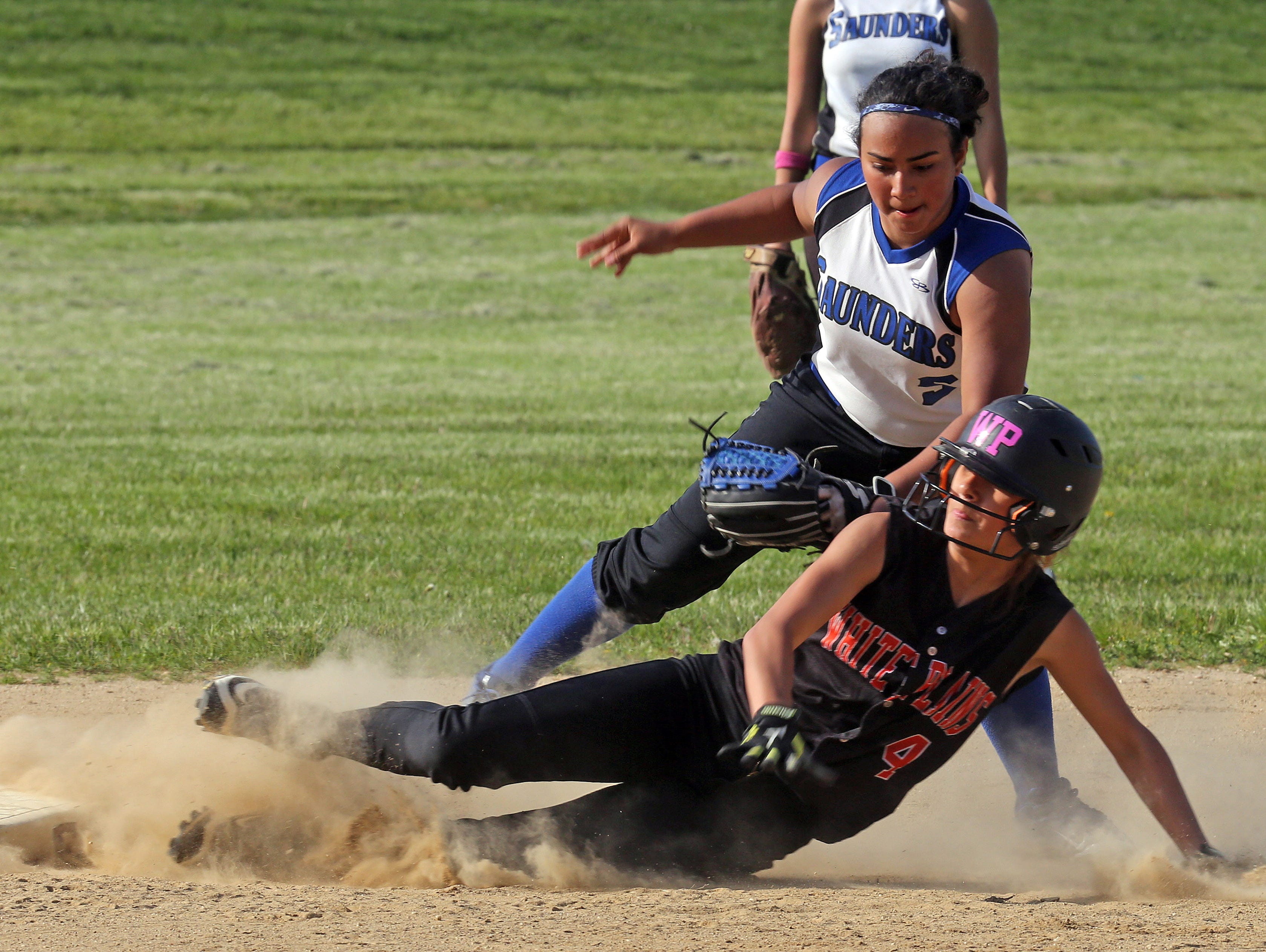 Stephanie Vega (19) of Saunders tags out White Plains Samantha Mendez (4) at second base during Class AA first round playoff softball game at Saunders High School in Yonkers on May 20, 2016.