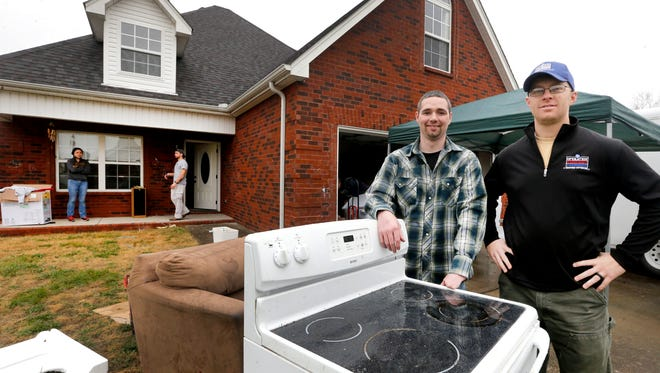 Army Veteran Rick Marsh, left and Operation Stand Down Tennessee's Michael McCoy stand in front of Marsh's home that is being restored through the help of Operation Stand Down Tennessee, Home Depot and other volunteers on Dec. 21, 2017, in Smyrna Tennessee.
