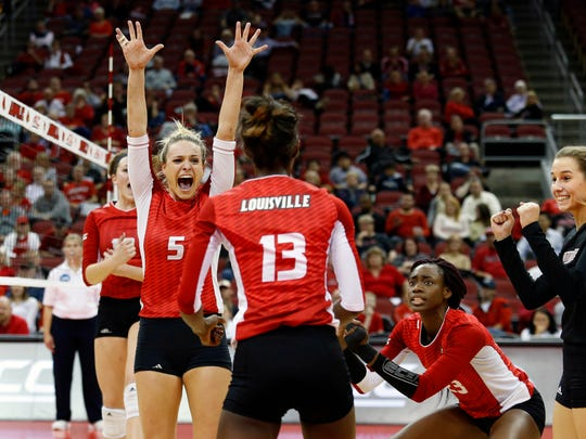 Louisville's Katie George (5), Maggie DeJong, left, Maya McClendon (13), Janelle Jenkins and Molly Sauer, right, celebrate after the Cards score against Pittsburgh. 