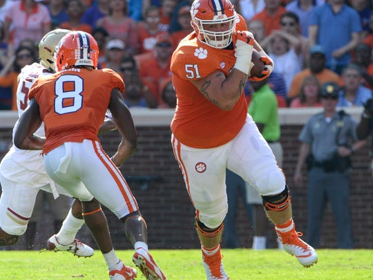 Clemson offensive lineman Taylor Hearn (51), right, runs with a loose ball near wide receiver Deon Cain (8) playing Boston College after quarterback Kelly Bryant(2) dropped it during the second quarter in Memorial Stadium at Clemson on Saturday.