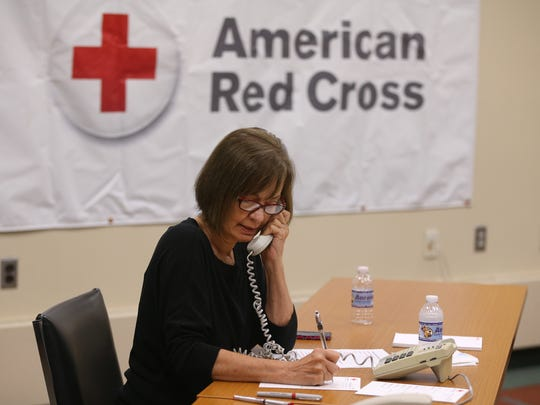 Shari Eduardo volunteers answering phones during a