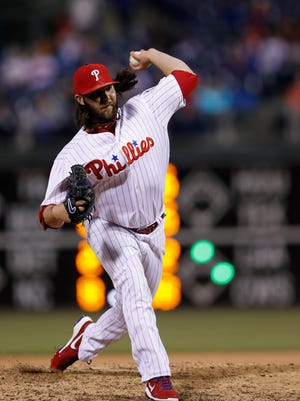 Phillies' James Russell in action during a baseball game against the New York Mets, Tuesday. He allowed two runs to the Mets during the outing. Russell was designated for assignment before Wednesday's game.