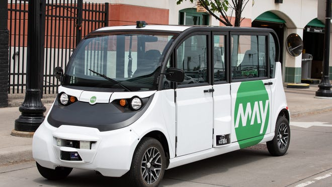 Self-driving electric shuttles begin service carrying Bedrock employees around downtown Detroit on June 26, 2018.