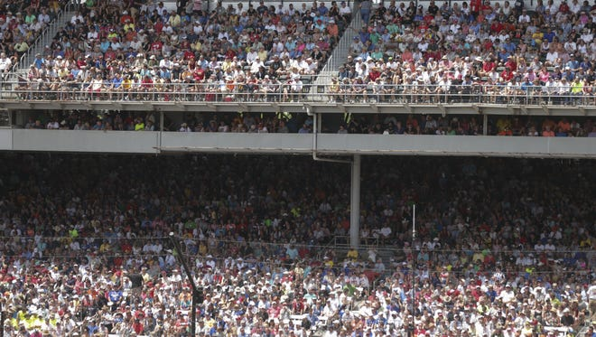 Fans, in a capacity crowd at the Indianapolis Motor Speedway before the 100th running of the Indianapolis 500, Sunday, May 29, 2016.