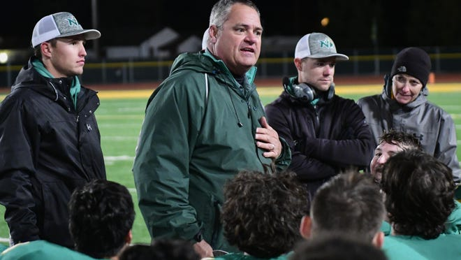 New Deal coach Matt Hill talks to his team after winning the District 2-2A, Division I title against Sundown on Nov. 9, 2018, at Noland Stadium in New Deal. The Lions are scheduled to hit the road to Wellington for a 7 p.m. contest Friday.
