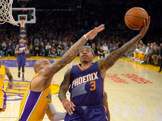 Isaiah Thomas shoots as Los Angeles Lakers forward