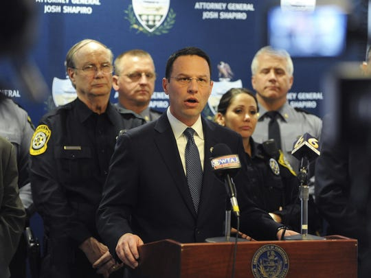 Pennsylvania Attorney General Josh Shapiro announces the arrest of Bedford County District Attorney Bill Higgins on 31 counts of obstruction, intimidation of witnesses, and hindering apprehension while in office, during a press conference in Bedford, Pa., Wednesday, April 4, 2018. Shapiro is surrounded by members of his office, the Pennsylvania State Police, and Bedford County Sheriff's Department. (John Rucosky/Tribune-Democrat via AP)