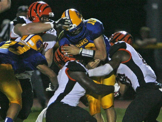 Manchester quarterback Jerry Ward is sacked by Barnegat