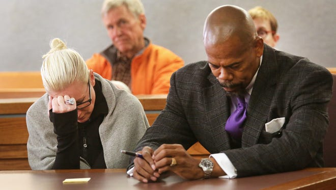 Crysta Pleatman and her attorney, Clyde Bennett II react after Pleatman was found guilty on one of the email harrassment charges stemming from the Indian Hill real estate case. The jury could not reach a verdict in the other charge and that case was dismissed. Sentencing is Nov. 17.