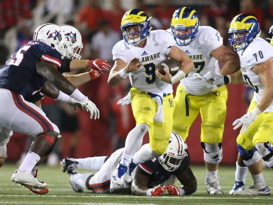 Delaware quarterback j. P. Caruso carries in the fourth quarter of the Blue Hens' 24-20 win at LaValle Stadium Saturday.