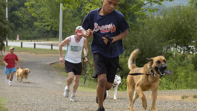 Participants take on the Tails and Trails 5K run at the Buncombe County Sports Park several years ago.