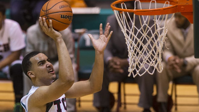 Arsenal Tech High School senior Trey Lyles (41) puts up a shot in the second half of boys varsity basketball action of the Indy Legacy Basketball Showcase Saturday, Jan. 4, 2014, at Arsenal Technical High School. Arsenal defeated Park Tudor 95-88.