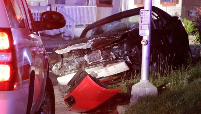 One of two cars involved in an accident rests at the corner of Lea Boulevard and Market Street in Wilmington shortly before 9:30 p.m. Thursday.