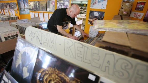 Andrew Czajka of Ridley, Pa., hunts through the offerings at Jupiter Records on Marsh Road near Arden.