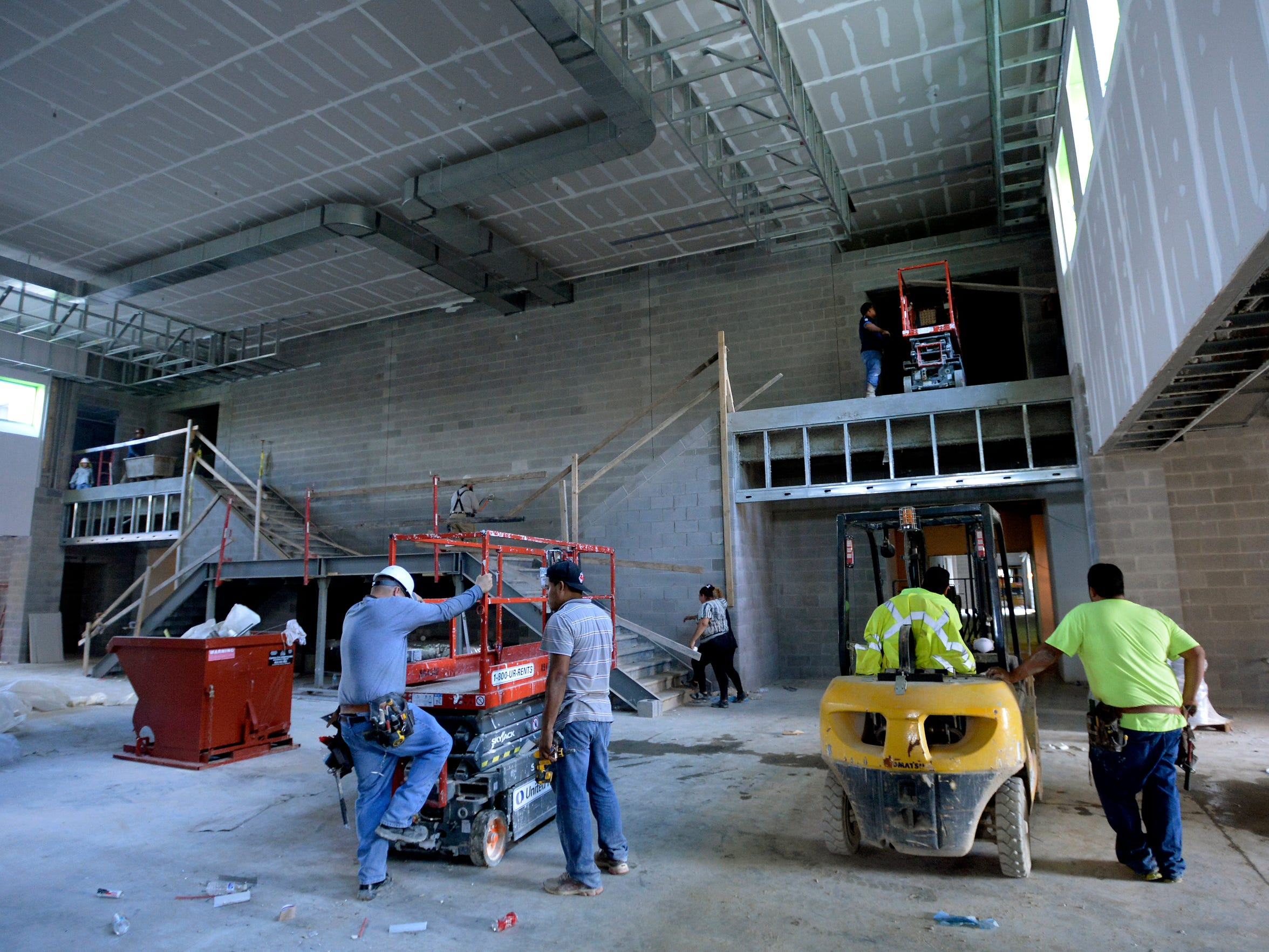 Builders work in the common area to be shared by the new elementary and middle schools in Thompson's Station on Wednesday, Aug. 23, 2017. The schools, which have not been named yet, are expected to open in fall 2018 to keep up with growth in Williamson County.