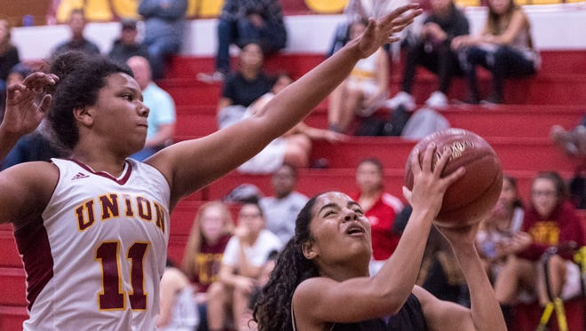 Tulare Union's Kiara Brown, left, was named the 2018 East Yosemite League most valuable player in girls basketball.