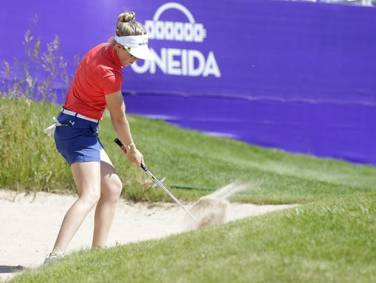 Casey Danielson practices bunker shots during a practice