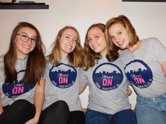From left, Asheville High School students Sarah Kate Head, Sawyer Taylor-Arnold, Isabelle Freireich, and Aidan Justus, are organizing the Asheville Women's March Jan. 20.