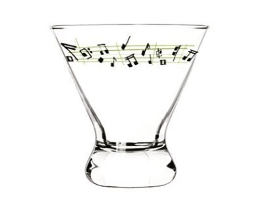 Black musical notes are scattered along a chartreuse staff on the Notetini glass designed by Ojai-based artist Sam Hamann.