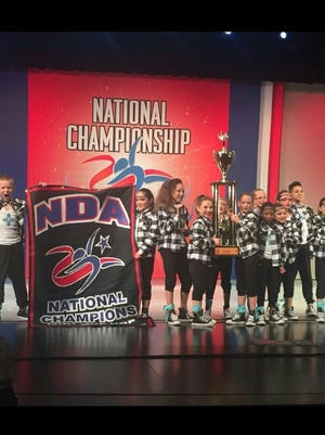 The mini hip hop Stunnerz team from Showtime Studio won back to back National Championships in the Mini Hip Hop Division at the National Dance Alliance National Championships held in Dallas. The team also won the Innovative Choreography award. The team was awarded a bid to compete at the Summit Championships to be held in Disneyworld in Orlando between April 30 and May 1. The Stunnerz team is pictured (left to right) Jesse Bailey, Andrea Sanchez, Captain Areyon Clay, Captain Victoria Schlenesig, Anika Duran, Captain Lauryl Matherly, Mackensie Haden, Aubrey Robertson, Camilla Santamaria, Adianna Hernandez, Scotte Benford, Kassidy Garrett and Augustine Candelaria. The team is coached by Lorrie Black, Sergio Elizaldez, and Misty Hernandez. Showtime Studio is located at the Otero County Boys and Girls Club in Alamogordo.