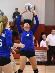 Setting the ball for a teammate Tuesday is Ladywood's