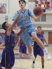 Rancho Mirage's Koby Alvarez goes for the basket against