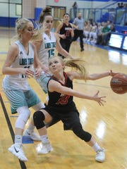 Roby's Hope Lambert, right, loses the ball while driving to the basket against May's Kelsie Gage, left, and Skylar Jenkins. May beat the Lady Lions 48-41 in the Region II-1A quarterfinal playoff game Tuesday, Feb. 20, 2018 at Winters.