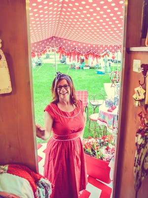 Thrifter Sisters Flea Market founder Renee Sturos of Fowlerville takes a look inside a vintage camper.