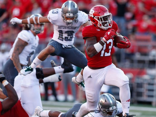 Rutgers Scarlet Knights running back Gus Edwards (13) rushes for a touchdown against Eastern Michigan Eagles during second half at High Point Solutions Stadium.